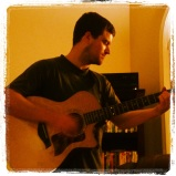 Kevin playing guitar